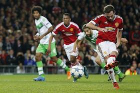 LEVELLER: Juan Mata (right) scoring the penalty to give Man United the equaliser in the 34th minute.