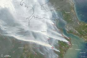 Nasa satellite image seen last month shows smoke from fires in Indonesia over the coasts of Borneo and Sumatra.