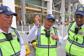 Mr Muhammad Taufiq Tahar (centre), and his colleagues Vincent Chan (left) and Mohamed Izwandi Min (right), rescued four people in a traffic accident