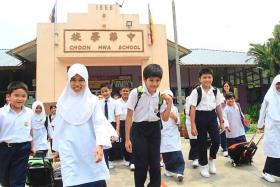 SJK pupils heading home after school.