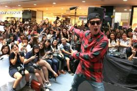 THRILLED: Ten fans out of 2,000 got to go on stage to hug Korean celebrity Gary Kang and be in a group photo with him.