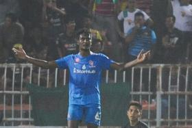 AWAY BLUES: Madhu Mohana and goalkeeper Izwan Mahbud (right) showing the LionsXII's frustration after conceding against Kedah.
