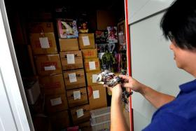 HUGE COLLECTION: Mr Isaiah Tay has more than 15,000 toys and keeps most of them in a 44.3 sq ft storage unit in Boon Keng, which costs him $270 a month.