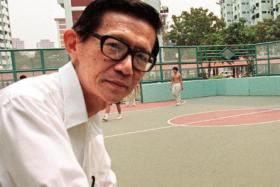 This file photograph taken on November 27, 1998m shows longtime Singapore political prisoner, Chia Thye Poh, standing at the side of a basketball court near his home.