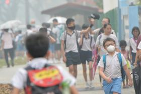 Students of Mayflower Primary School taking precautionary measures by wearing masks as hazy skies returned as schools across Singapore reopened on Sept 28.
