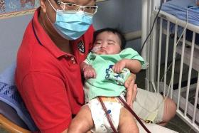 SHARING: Mr Jeremy Chew hopes to raise awareness of infant organ donation by talking about his son Aiden's condition.