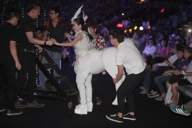 HORSING AROUND: Getai artiste Lee Pei Fen performed the opening number in centaur costume on a 3m-high platform on stage.
