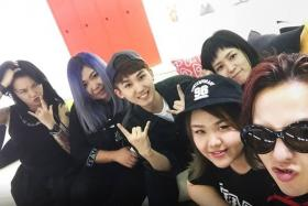 G-Dragon (extreme right), constantly hugged his guests like Singaporean Merissa Tee (beside him in cap), during their stay in his second home in Seoul.