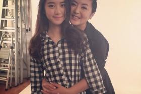 Quan Yifeng (right) hugs her daughter Eleanor Lee.