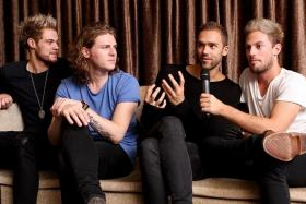 HARROWING: (From left) Lawson's bassist Ryan Fletcher, guitarist Joel Peat, vocalist Andy Brown and drummer Adam Pitts talking about Brown's experience with liver failure.