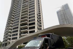 POLICE: A police hearse leaving the Leedon Heights condominium.