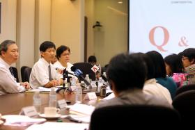SERIOUS: (Above, from left) Prof Fong Kok Yong, chairman of SGH's Medical Board, CEO Prof Ang Chong Lye and Chief Nurse Dr Tracy Carol Ayre at the media briefing at SGH yesterday.