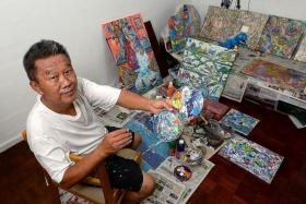 ART STUDIO: (Above) Mr Tan in his 'studio', which is one of the rooms in a three-room Circuit Road flat he shares with his brother.