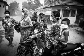 EDUCATION: Residents in the village of Bereng Bengkel in Central Kalimantan wearing the N95 masks - a first for some of them.