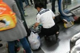 Security personnel tried to rescue the boy (wedged underneath the escalator's handrail) but he didn't survive.