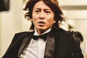 Suave veteran Japanese actor Takuya Kimura in a scene from Hero