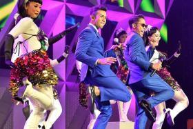 FUN: (Above) Taufik Batisah and Malaysian singer Hazama performing a medley.