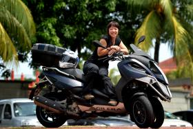 A member of Sheriders Chapter, the petite Ms Cheryl Chan loves the feeling of being on her Gilera Fuoco 500.