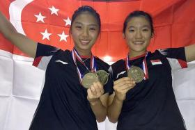 Yeo Jia Min (above, left), posing with her gold medal with doubles partner Crystal Wong (right)
