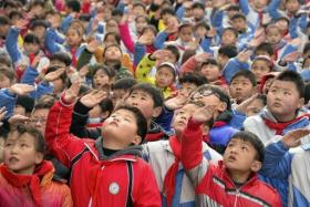 Children on the first day of their new semester at a primary school. China is relaxing it's 'one child policy' to in response to demographic 'timebomb'