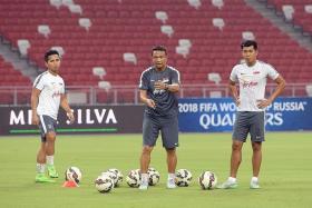 Khairul Amri (far right, with assistant coach Fandi Ahmad and Sahil Suhaimi)