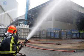 The Singapore Civil Defence Force  ( above ) deployed four water jets.