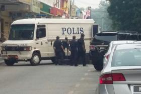 Police bomb squad rushed to the scene after a bomb goes off at a Malacca bank's ATM.