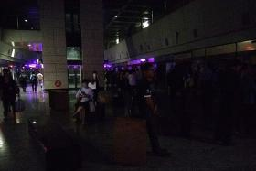 IN THE DARK: Hougang MRT station during the blackout..