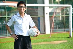 NEVER STOP LEARNING: Yangzheng Primary School's football coach Samuel Chan reads books on the game to improve his knowledge and training methods.