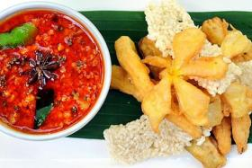 CHARM: Crispy rice with natang sauce at Chanrey Tree restaurant.