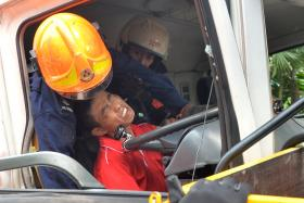 RESCUED: A trailer driver was trapped after his vehicle collided with a truck on the AYE yesterday. It took SCDF rescuers almost an hour to free the driver from the cabin.