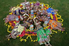 Women dressed in traditional attire posing after taking part in rehearsals for the Navratri festival in Ahmedabad, India.