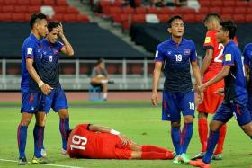 BLOW: Khairul Amri (above) writhing in pain after injuring his hamstring against Cambodia on Tuesday. He will be out for the LionsXII's next two Malaysia Cup games.