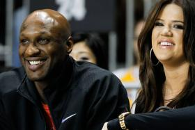 A file picture of Lamar Odom and his then-wife Khloe Kardashian attending the 2011 BBVA All-Star Celebrity basketball gam