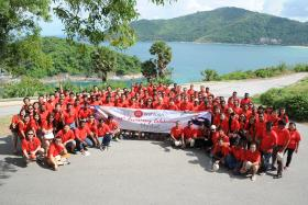 CELEBRATING: Staff of Wah Loon Engineering (above) celebrating their company's anniversary in Phuket, Thailand.