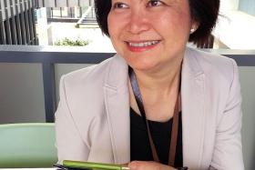 PASSIONATE: Corporate communications executive Penny Chua (above) helped to reunite a mother and son who were separated for over 10 years. She later received pictures of their reunion on her phone.