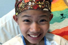 CHEERY: Cherrii Lim wearing one of the many caps she got from wellwishers when she became bald after chemotherapy.
