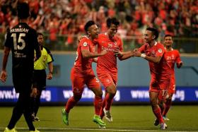HOME JOY: Sahil Suhaimi (far left) and Faris Ramli (above) celebrating with goalscorer Shahdan Sulaiman.