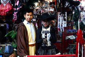 (Above) Founder of Customade Costume & Merchandise Mr Sanee Neo and marketing executive Kathy Tam in their favourite Halloween costumes.