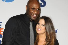Lamar Odom and wife Khloe Kardashian-Odom in a 2012 file photo.