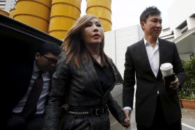 City Harvest Church founder Kong Hee and his wife Sun Ho, also known as Ho Yeow Sun, arrive at the State Courts earlier this morning (Oct 21).