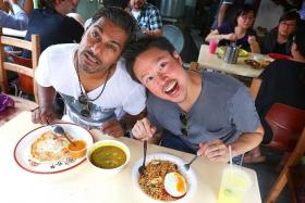 GOURMET? Rai Kannu (left) says his bandmate Jack Ho is a roti prata connoisseur. Soup kambing Plaster prata