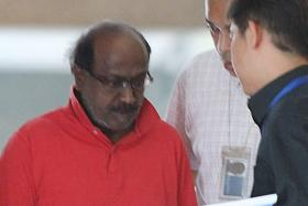 ACCUSED: Govindasamy Nallaiah, accompanied by police officers, was taken to the scene of the murder in August 2011.