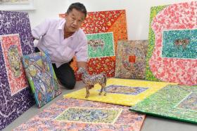 COFFEE ART: Mr Tan with pieces of his art.