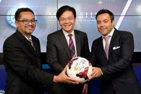 BIG BUCKS: From far left, Football Association of Singapore president Zainudin Nordin; Minister for National Development Lawrence Wong and MP & Silva founding partner Andrea Radrizzani announce a $25 million sponsorship deal.