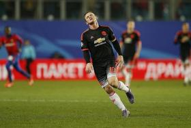 RUE THAT: Our writer Neil Humphreys believes that Wayne Rooney (above) slows United's attack and hinders Anthony Martial's progress.