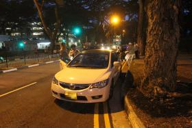 AT THE SCENE: The car that is believed to have been involved in the accident at Henderson Road on Monday evening.