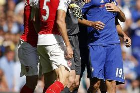 CONTROVERSIAL: Chelsea players preventing Diego Costa from clashing with Arsenal's Gabriel Paulista in a match on Sept 19. The Spaniard was subsequently given a three-match retrospective suspension for his violent conduct in that match.