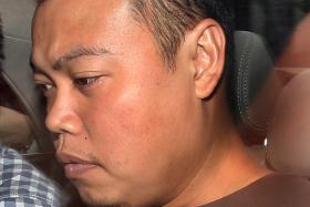 ACCUSED: Former police officer Iskandar Rahmat is now on trial for the murders of Mr Tan Boon Sin and his son, Mr Tan Chee Heong.