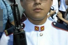 TRAGIC: Third Sergeant Tang Liang Wei, 23, died on the spot.
